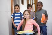 Disabled pupil with his friends in classroom at the elementary school poster