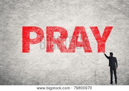 Asian businessman write text on wall, Pray