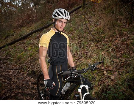 Cyclist In The Forest