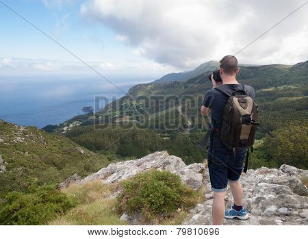 Photographer Sightseeing And Photographing A Beautiful Coastal Landscape In Galicia