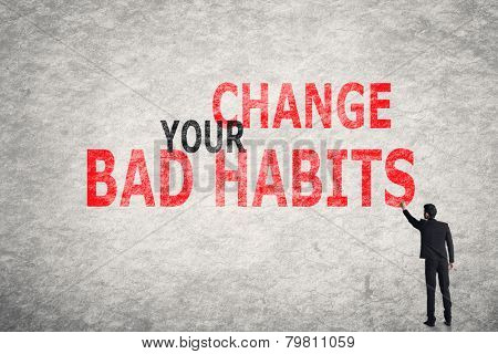 Asian businessman write text on wall, Change Your Bad Habits