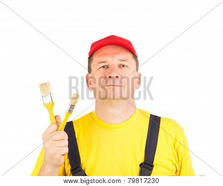 Worker shows painting brushes.