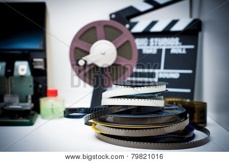 A Vintage 8Mm Movie Editing Desktop With Reels And Clapper