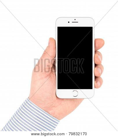 iPhone 6 in hand on white background turned off.