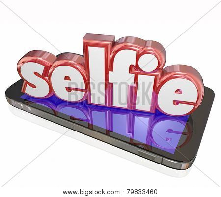 Selfie word in 3d red letters on a smart phone or digital camera to illustrate taking self portraits and posting them to social media websites
