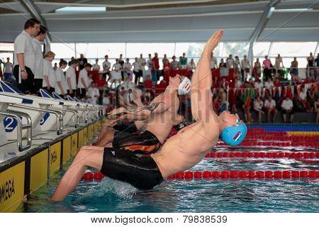 GRAZ, AUSTRIA - APRIL 04, 2014: Robert Zbogar (Slovenia) places 6th in the men's 50m backstroke event in an indoor swimming meeting.