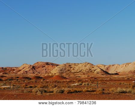 The colourful earth in the desert at sunrise