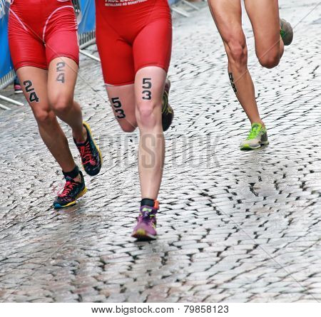 STOCKHOLM - AUG 23 2014: Female triathlon feet and legs in the ITU World Triathlon series in Stockholm Sweden poster