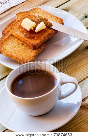 Breakfast Time: Cup Of Milky Coffee, Rusks And Orange Jam With Butter