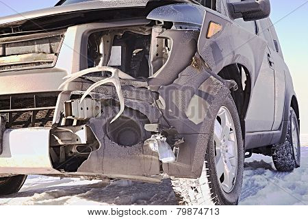 Car Damage From HIgh Speed Collision With Deer In The Snow