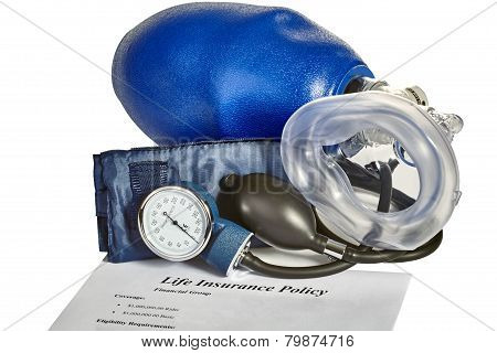 An emergency medical blood pressure monitor with CPR artificial ventilator mask and life insurance policy on white background. poster