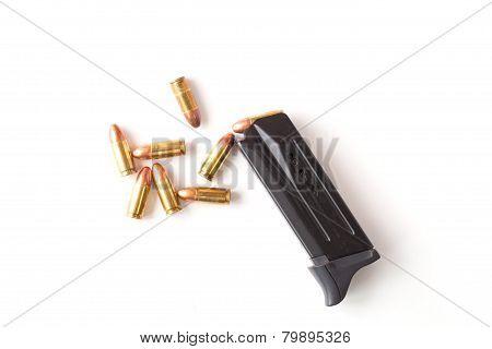 Magazine gun and bullet on white background.
