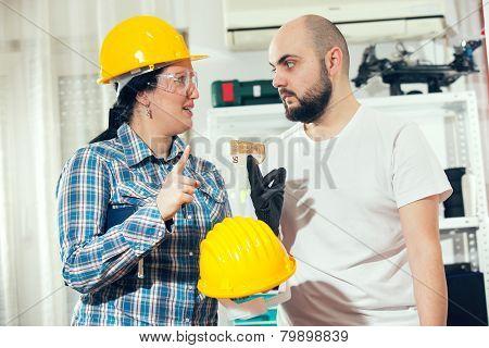 Craftsman and craftswoman posing together, selective focus