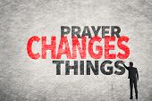 Asian businessman write text on wall, Prayer Changes Things poster