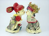 Porcelain oriental wedding dolls in traditional costume poster