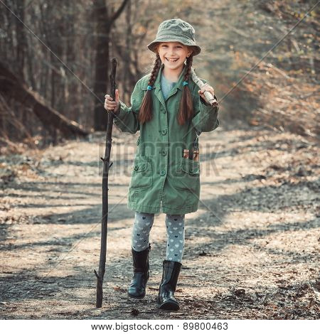 little girl goes through the woods with stuff, photo in vintage stylev