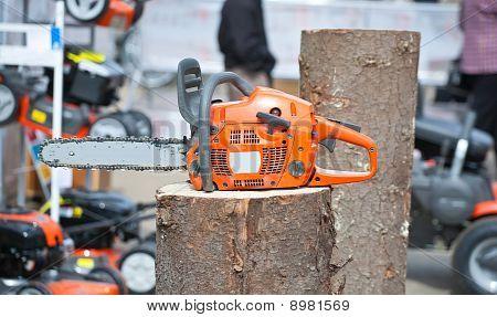 Chain Saw On Log