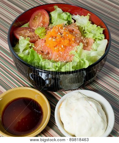 A Bowl Of Boiled Rice With Salmon And Vegetable