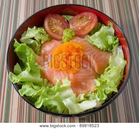 Bowl Of White Rice Topping With Salmon