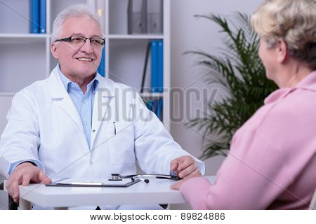 Elder woman having medical consultation in doctor's office poster