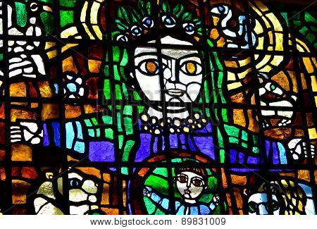 woman holds a child multicolored stained glass