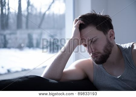 Young attractive sleepy man taking a short nap poster