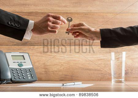 Businesswoman Handing Over A House Key