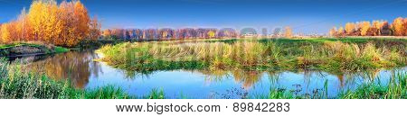 Mellow autumn on river panoramic