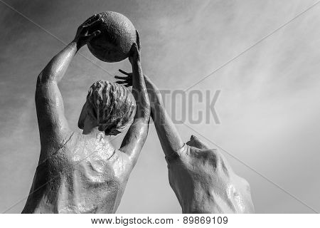 Stone Statue Of Women Netball Players In Action