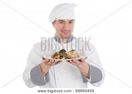 Chef Showing And Holding A Plate Of Prepared Food