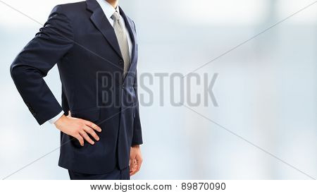 Impersonal portrait of a businessman against a bright background