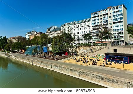 People Are Relaying At The Beach Of The Danuvia Canal In Vienna