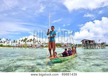 Bajau Laut Kids On A Boat In Maiga Island On April 19, 2015