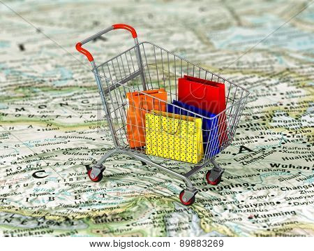 International Shopping. Colorful Package In The Shopping Cart On The World Map. World Trade Concept.