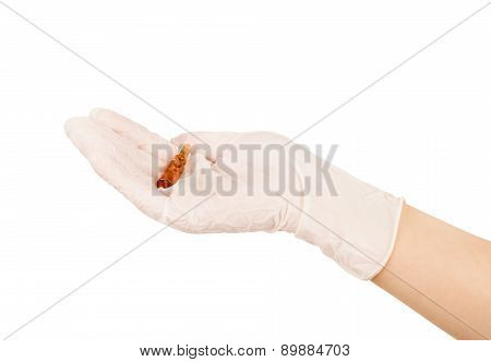 Medical Ampoules In A Hand On A White Background