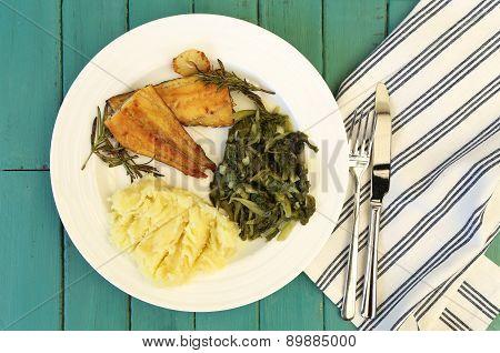 Grilled Smoked Haddock Fillet, Mash Potato, Swiss Chard On White Plate