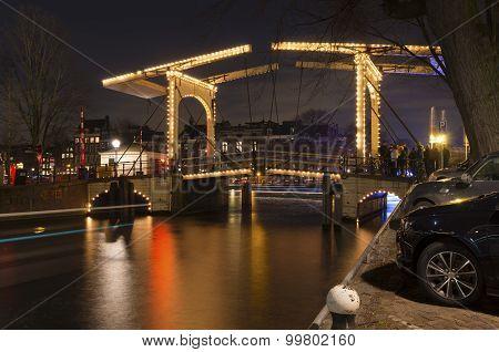 nightshot of an illuminated bridge in amsterdam netherlands