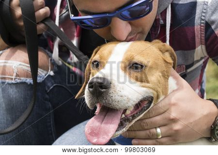 Close-Up of Dog Lover Giving His Pet A Kiss