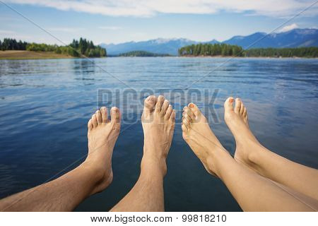 Couple relaxing on a beautiful Mountain Lake shore