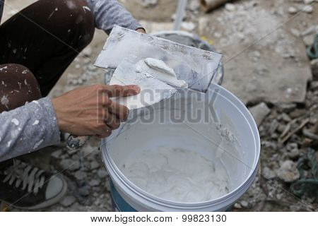 Plasterer Mixing A Plaster In Bucket