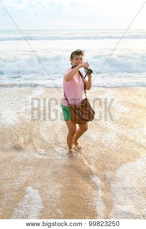 Woman Happy Taking Picture On The Beach