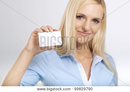 woman holding a blank card