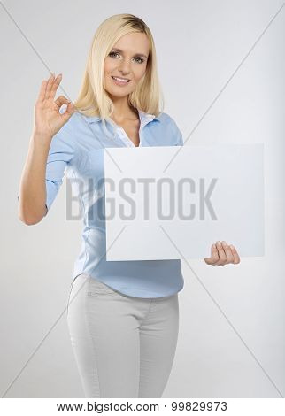 woman with sign board and showing okay gesture