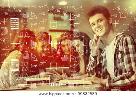 Maths against smiling friends sitting studying and using tablet pc