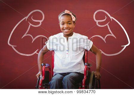 Girl sitting in wheelchair in school corridor against desk