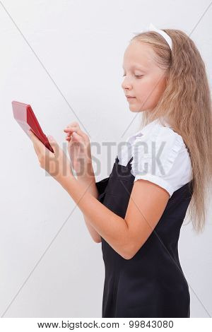 Portrait of teen girl with calculator on white background