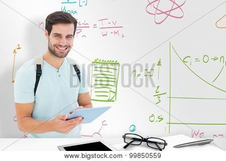 Student using tablet pc against desk
