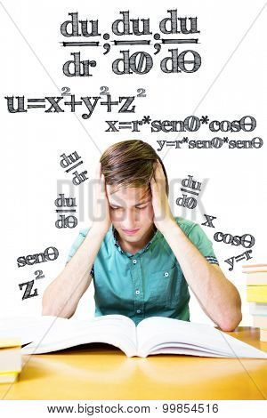 Student sitting in library reading against math equation