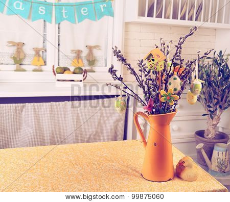 Pussy Willow Branchs in a vase with Easter eggs on the table in the studio