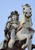 knight's statue at the plaza de commercio in lisbon / portugal. poster
